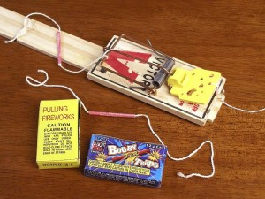Finished Mouse Trap Booby Trap project and boxes of pulling fireworks