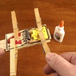 Clamping the mouse trap to the stick while glueing